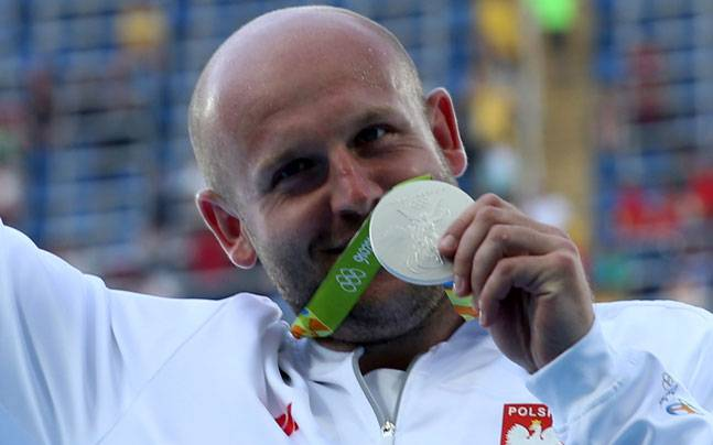 Polish athlete puts Olympic medal up for sale to help boy with cancer