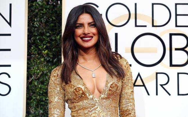 Priyanka Chopra's gold outfit paid a beffiting tribute to the glitzy Golden Globes red carpet! Photo: Reuters