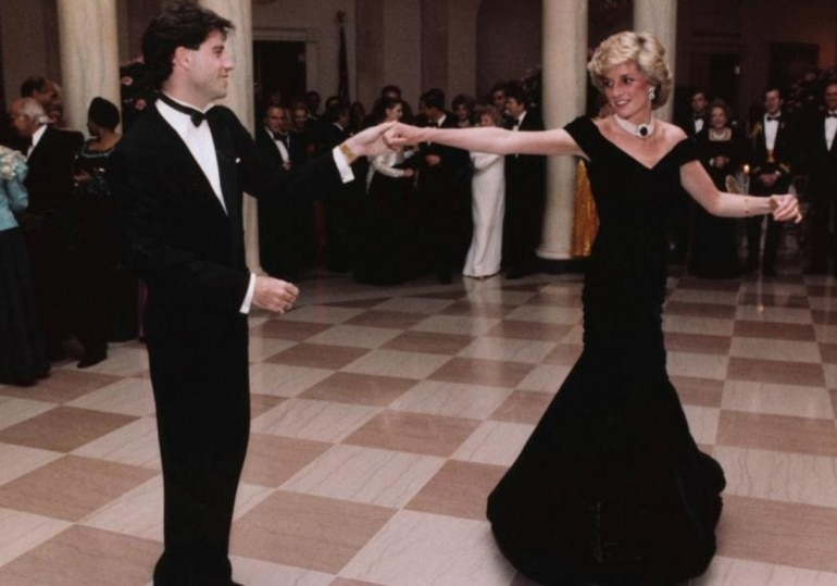 Actor John Travolta dances with Princess Diana at the White House