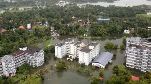 An aerial view shows partially submerged buidlings at a flooded area.