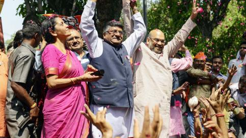 (From left) Nirmala Sitharaman, Ravi Shankar Prasad and Amit Shah celebrate BJP's victory at the party headquarters in Delhi
