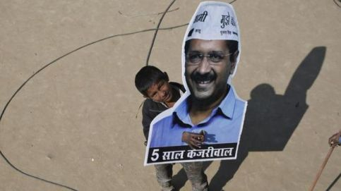 A child holds Arvind Kejriwal's cut-out