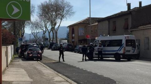 Police are seen at the scene of a hostage situation in a supermarket in Trebes in France. (LA VIE A TREBES/via REUTERS)