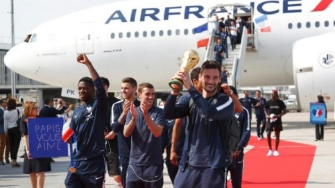 France captain Hugo Lloris holds the World Cup as the French soccer team arrives in Paris (AP Photo)