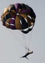 An adventure lover performs parasailing during the week-long Bhoj Adventure Festival in Bhopal.