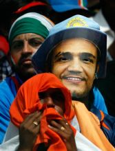 An Indian fan wears the mask of India cricketer Virender Sehwag