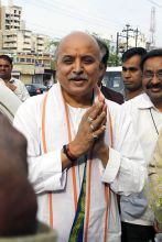Vishva Hindu Parishad (VHP) leader Pravin Togadia addresses a press conference in Bhopal on Godhra train fire verdict