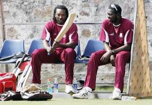 West Indies cricketers Sulieman Benn and Chris Gayle.