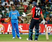 England captain Andrew Strauss (right) and India bowler Zaheer Khan have a verbal exchange.