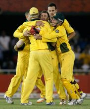 Australia players celebrate the wicket of India's Gautam Gambhir
