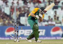 South Africa batsman Colin Ingram's wicket are shattered by Ireland's Trent Johnston
