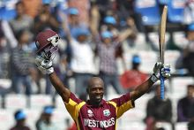 West Indies batsman Devon Smith reacts after scoring a century
