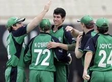 Irish cricketers congratulate George Dockrell (centre), after he scalped South Africa's Morne van Wyk