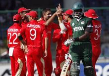 Harvir Baidwan celebrates the wicket of Kenya's Collins Obuya