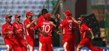 Canada's Henry Osinde (fourth from left) celebrates the wicket of Kenya's Seren Waters