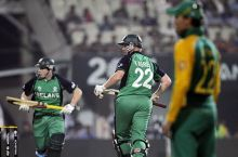 Ireland's Kevin O'Brien (centre) and Gary Wilson (left) run between the wickets
