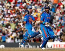 India's Virat Kohli (left) and Yuvraj Singh run between the wickets