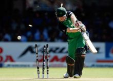 Ireland batsman Paul Stirling's stumps are shattered by India pacer Zaheer Khan