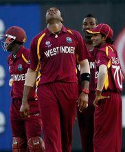 West Indies bowler Kieron Pollard (centre) celebrates the wicket of India's Yuvraj Singh
