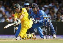 Australia captain Ricky Ponting plays one to the boundary off India's Yuvraj Singh