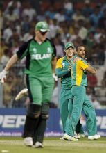 South Africa's left-arm spinner Robin Peterson (right) and team-mate Faf du Plessis celebrate the dismissal of Ireland's Kevin O'Brien