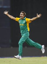 South Africa leg-spinner Imran Tahir reacts after claiming the wicket of New Zealand batsman Ross Taylor