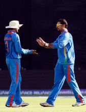 India bowler Yuvraj Singh celebrates the wicket of Ireland's Kevin O'Brien