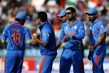India's Yuvraj Singh and team-mates celebrate the wicket of the Netherlands' batsman Ryan ten Doeschate