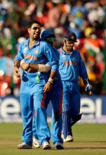 India's Yuvraj Singh celebrates the wicket of Ireland captain William Porterfield