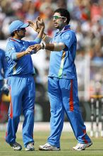 India's Yuvraj Singh celebrates the wicket of Australia batsman Brad Haddin