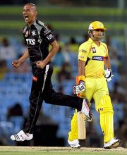 Pune paceman Alfonso Thomas celebrates the wicket of Chennai batsman Suresh Raina