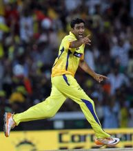 Chennai spinner R Ashwin celebrates the wicket of Pune batsman Robin Uthappa