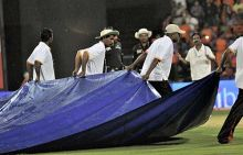 Ground staff pull the covers