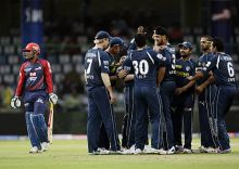 Hyderabad players celebrates the dismissal of Delhi opener Virender Sehwag