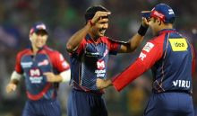 Delhi medium-pacer Ashok Dinda celebrates after scalping Bangalore opener Tillakaratne Dilshan