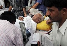 A doctor checks Anna Hazare's blood pressure during his fast in Delhi.