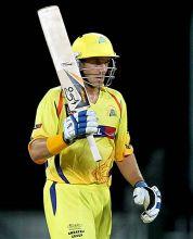 Chennai opener Michael Hussey raises his bat post his half-century