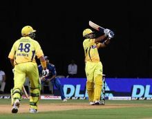 Chennai opener Murali Vijay plays a shot as Michael Hussey looks on
