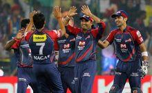 Delhi skipper Virender Sehwag and team-mates celebrate