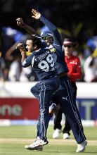 Hyderabad spinner Amit Mishra celebrates the wicket of Mumbai batsman Ambati Rayudu