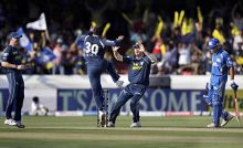 Hyderabd left-arm spinner Pragyan Ojha (centre left) celebrates the wicket of Mumbai batsman Kieron Pollard