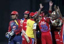Delhi captain Virender Sehwag walks back after being run out on 25