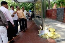 Officials inspect the site near Gargi College