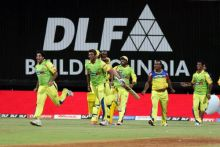 Chennai team run to greet teammates after their win over Bangalore
