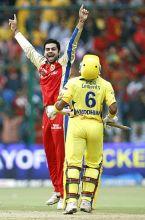 Bangalore's Virat Kohli celebrates the dismissal of Chennai batsman Wriddhiman Saha