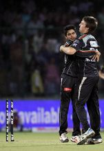 Pune paceman Mitchell Marsh is hugged by team-mate Manish Pandey