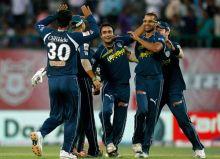 Hyderabad leggie Amit Mishra (centre) celebrates the dismissal of Punjab batsman Ryan Harris with team-mates