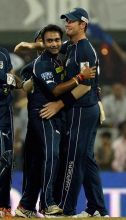 Hyderabad leg spinner Amit Mishra celebrates the wicket of Pune batsman Robin Uthappa with team-mate Daniel Christian