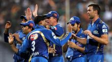 Mumbai players celebrate the wicket of Yusuf Pathan