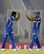 Mumbai paceman Munaf Patel and Andrew Symonds